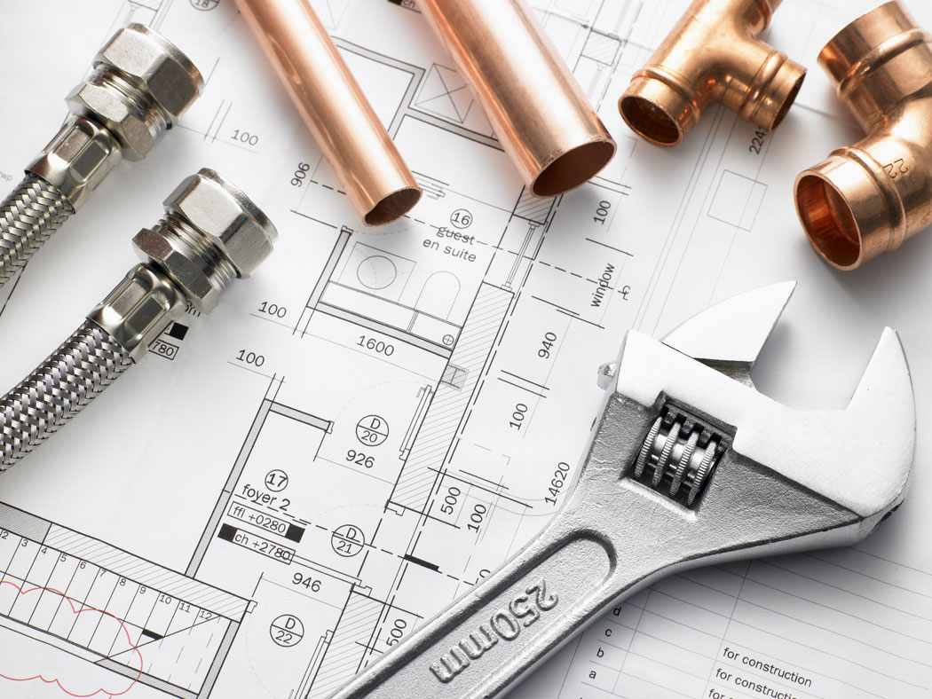 Image of plumber pipes, plans and plumbing components