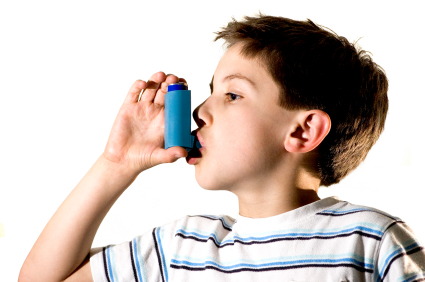 Image of a boy with an athsma aspirator