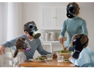 Image of family wearing gas masks