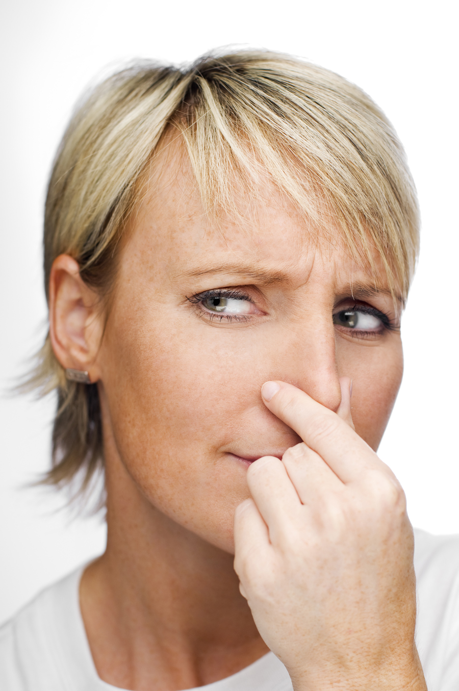 Image of woman holding her nose due to bad sewer gas smell