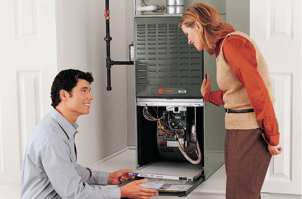 Image of technician showing homeowner how to maintain the furnace filter