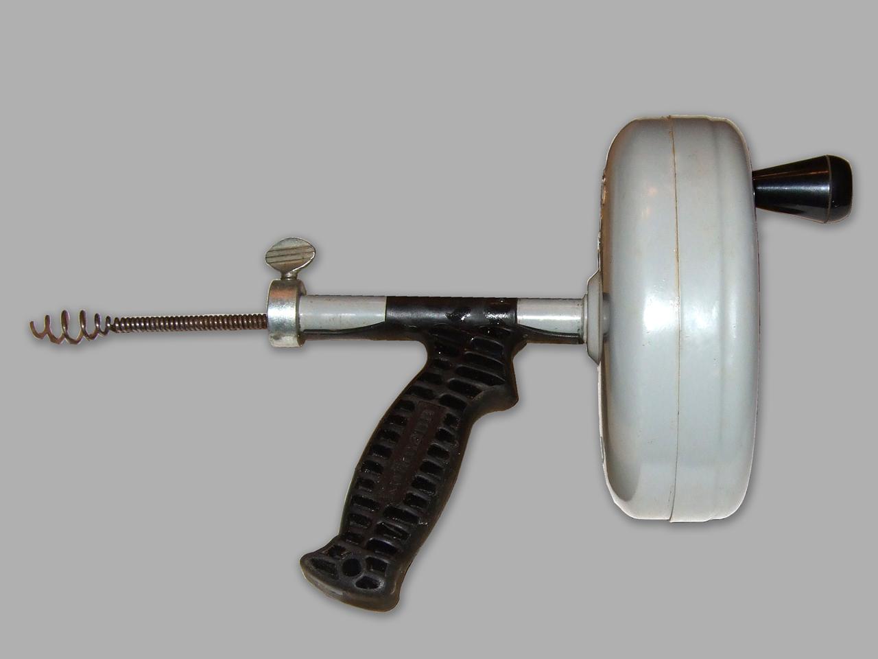 Image of plumbers handheld drain auger