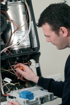 technician servicing a boiler