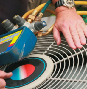 techincian fixing an air conditioner