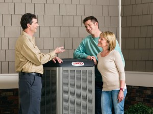 air conditioning sales person with couple