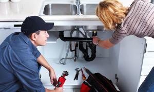 plumber repairing sink trap