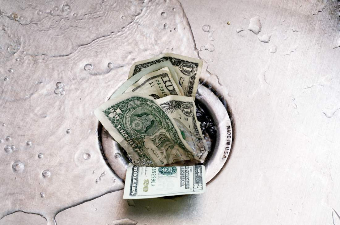 money going down a sink drain