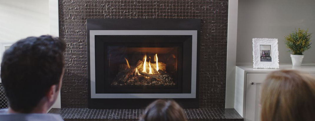family in front of gas fireplace