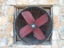 Image of a Large Fan Mounted in a Stone Wall